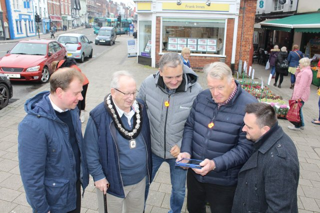 Bill Young From Intechnology (Centre) Shows Ashby Mayor Councillor Graham Allman (Centre Left) and Town Council Leader John Coxon How to Log Into the New Wi Fi in Ashby.