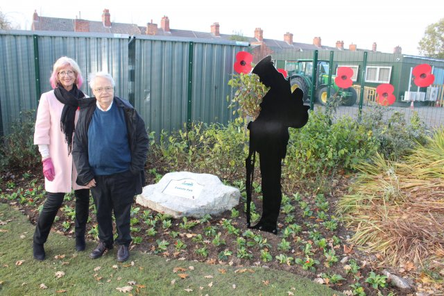 Cllrs alison smith and john legrys with the new plaque and soldier in coalville park