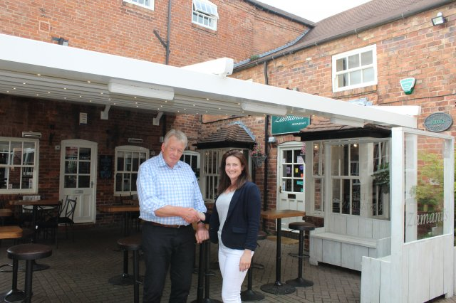 Councillor john coxon congratulating kate zamani on the improvements made to the wine bar and the cocktail bar