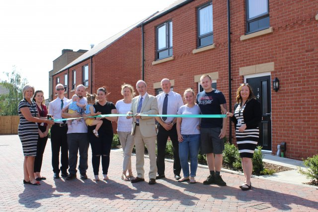 Councillor Roger Bayliss Portfolio Holder for Housing at NWLDC Joined by Council Officers a Representative From the Developer Countryside and Tenants