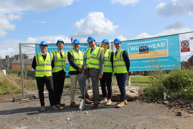 Glyn Jones Director of Housing at NWLDC (Centre with Spade) Is Joined by Partners From Woodhead Construction at the Former Cocked Hat Site.