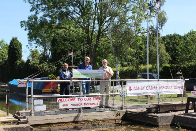 (l-r) NWLDC chairman Virge Richichi and council leader Richard Blunt presenting a cheque to Peter Oakden - Chairman at Ashby Canal Association