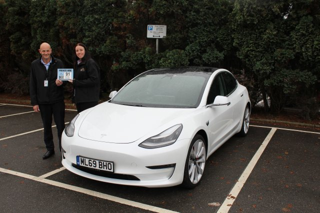 NWLDC Licensing Team Leader Andy Cooper Issuing Kelly Hagger with the Licence Plate for CK Cars' New Tesla