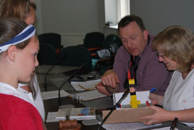 Pupil casey kendrick explains her team's clock tower model to nwldc chief executive bev smith and head teacher richard dax