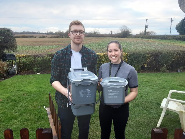 Resident Charlie Measham with Recycle More Officer Lily Walker and the Two Food Waste Bins