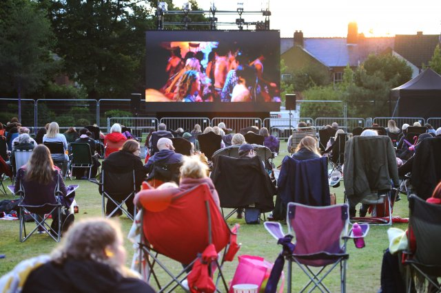 Residents and visitors enjoying the Cinema in the Park event at Coalville Park