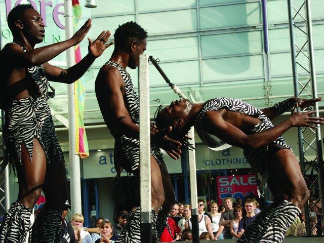 The Black Eagles Acrobats Doing the Limbo