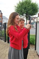Belvoirdale primary school pupils isabelle barrs and kyle smith visiting the coalville memorial clock tower to do some research ahead of their project.