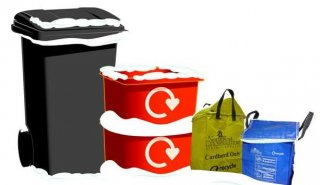 Black refuse bin & recycling containers together in snow
