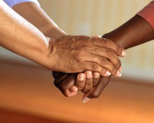 Hands linked together - supporting each other